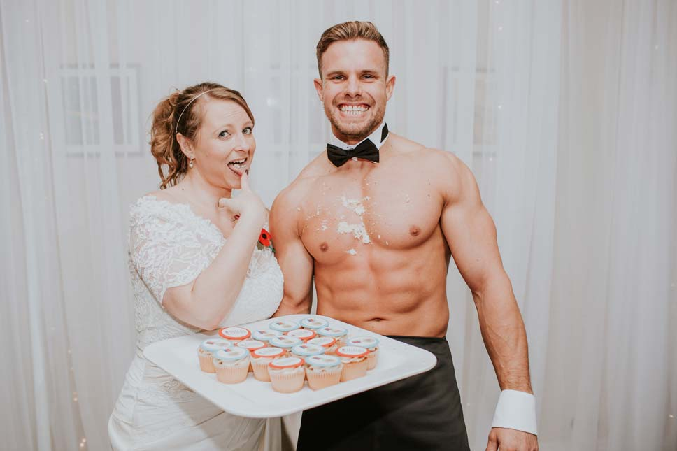 A bride enjoying a cupcake (and a Butler in the Buff!) (D&A Photography)