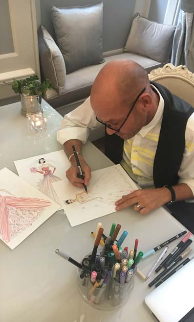 Bridalwear designer Ian Stuart at work