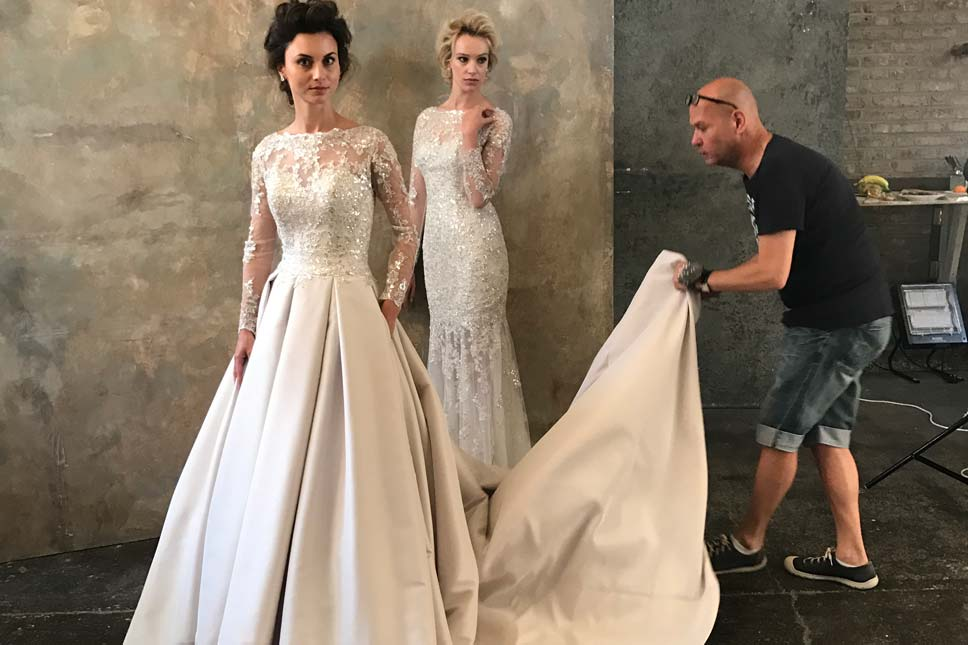 Ian Stuart styling models at his boutique