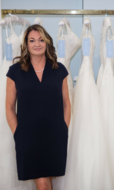 Bridal Retailer, Stephanie Hanks in her boutique