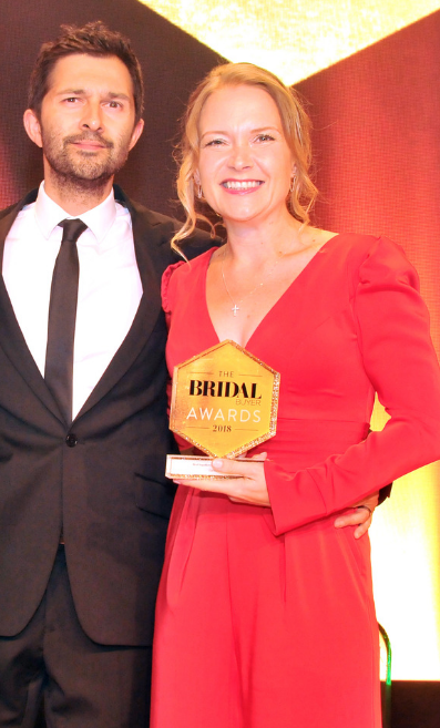Maria Ryan and her husband Simon winning their second Bridal Buyer Award