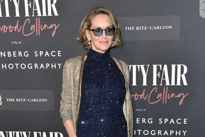 Sharon Stone Wears Jumpsuit Designed by Gill Harvey to Vanity Fair Exhibition